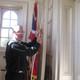 Rector John Schaeffer rings the church bell.