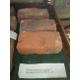 A display case holds artifacts from the church's past, including these two bricks which were marked with the footprint of a person.