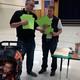 Chad Evans, PTA Coordinator, gives information to a father. (Rubina Halawani/City Journals)