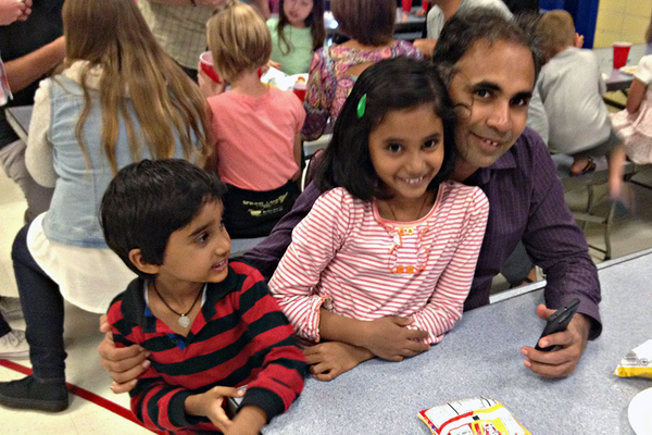 Fathers and kids enjoy the Watch DOGS kick-off event, Pizza Night. (Rubina Halawani/City Journals)