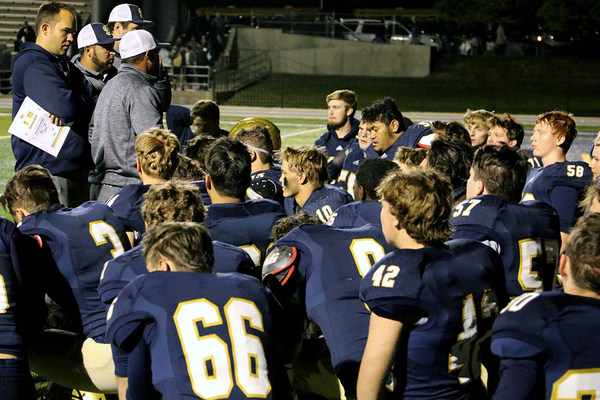 Coach Zac Erekson counsels his team after a 33-30 loss to Kearns High School on Oct. 7. Though this game marked the team's second close loss in three weeks, the Eagles are fighting to end the season on a winning note. (Robert Dudley/Holladay resident and team photographer)