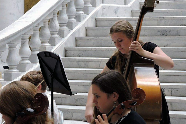 Kathryn Black, a ninth-grade student, performs with the Oquirrh Hills Middle School Symphonic Orchestra at the Utah State Capitol on Oct. 3. The performance was Kathryn's first time playing the bass in front of an audience. (Jordan School District)