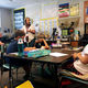 Principal Debora Cluff helps the students understand what the newscast is going to be for. (Natalie Mollinet/The City Journals)