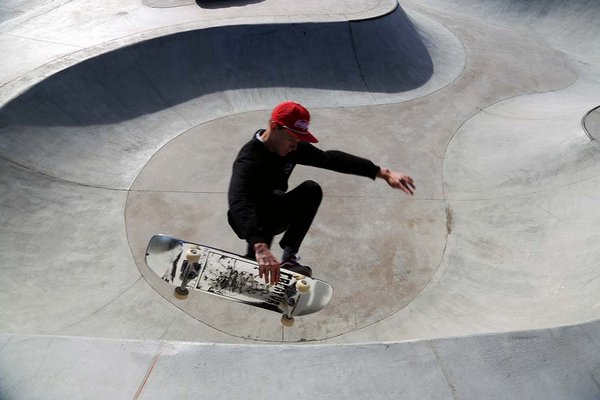 A skateboarder performs a trick over the doorway, located underneath the beginning of the snake run. The snake run is one of the more popular attractions of the skate park. (Keviin Conde/West Valley City)