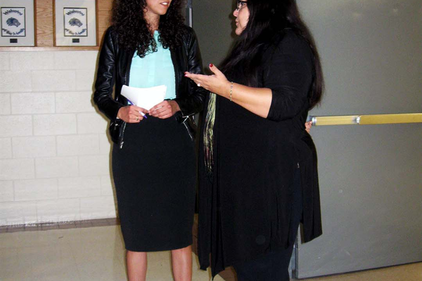 Isabel Rojas (left) was the emcee at the Latino Family Night on Oct. 6 at Hunter High School. Rojas is the director of systems and operations for Latinos in Action. (Travis Barton/City Journals)