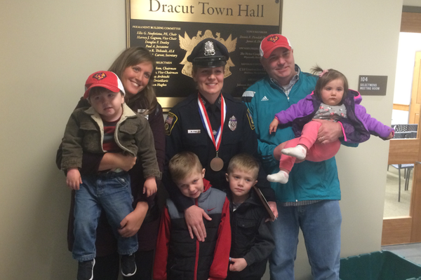 The Middleness Family, along with Det. Megan Pike and her sons.