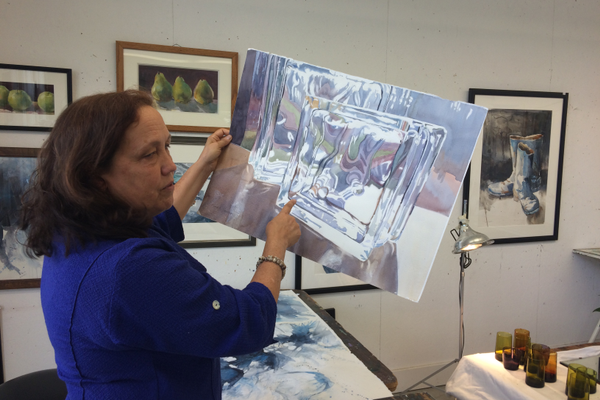 Sarah Yeoman with a demo painting from a recent class on painting translucent objects.
