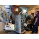 Registered Nurse Pete Keiley looks on as a member of the Draper Chamber of Commerce tries out the Da Vinci robot. The robot will be used primarily for urologic surgeries. (Kelly Cannon/City Journals)