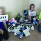 Kylie Johnson, Lexi Spencer and Rachel Sweat, of troop 2542, raised enough money to donate 217 pair of socks to the Road Home homeless shelter. (Elizabeth Martin-Sweat/Girl Scout volunteer)