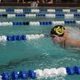 Senior Cassadee Bunten swims the 100-yard butterfly at a swim meet on Nov. 17 at the Marv Jensen Recreation Center. (Travis Barton/City Journals)