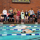 Coaches and members of the Cottonwood High swim team look on during the 500-yard freestyle race on Nov. 17 at the Marv Marv Jensen Recreation Center. (Travis Barton/City Journals)