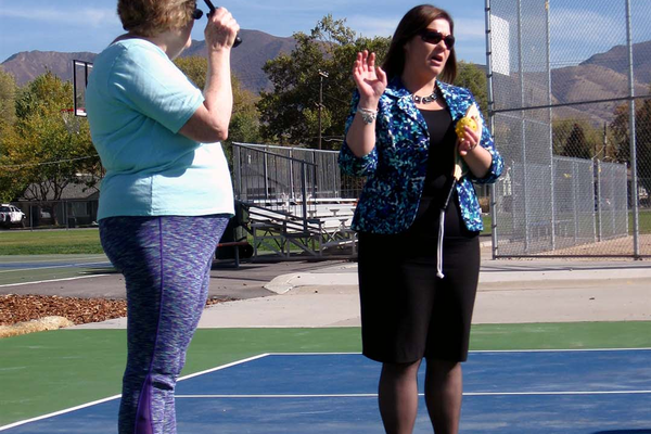 Mayor Cherie Wood speaks to the crowd at the ribbon cutting ceremony for two new pickleball courts on Oct. 27 at the Columbus Center. (Travis Barton/City Journals)