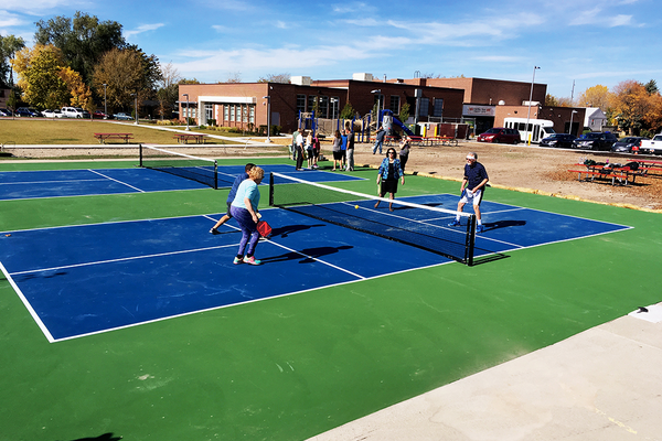 City officials and members of the community were on hand for the ribbon cutting ceremony for two new pickleball courts on Oct. 27 at the Columbus Center. (Travis Barton/City Journals)