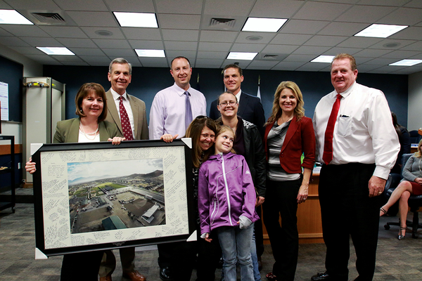 Herriman City officials gather around Danie Bills and her family to present her with a framed aerial photograph of the park she helped the city create. Bills worked for the Herriman for more than 13 years but decided to take a new job at the Salt Lake County Sherriff's Office, much to the dismay of Herriman officials. (Destiny Skinner/Herriman City)