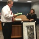 Herriman City Manager Brett Wood and former events and recreation manager Danie Bills hold back tears as Wood presents a parting gift from the city to Bills. After more than 13 years working for Herriman City, the well-liked Bills accepted a job with the Salt Lake County Sherriff's Office. (Tori La Rue/City Journals)