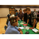 Students pretend to sign up for the military during Copper Mountain Middle School's Reality Town mock-life activity. The purpose of the event was to get ninth-graders to begin seeing options for their future. (Tori La Rue/City Journals)