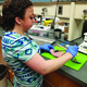 Kimberly McClellan tests properties of chicken meat at a Utah State University meat lab. McClellan performed the tests as part of a science project through the Future Farmers of America organization. (JoLyn McClellan)