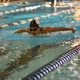 Sophomore Olivia White swims the 100-yard butterfly on Nov. 4 at the Stein Youth Aquatic Club. (Cindy Nordstrom/Highland swim team)