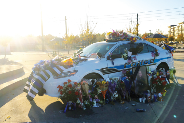 West Valley City Police Officer Cody Brotherson died in the line of duty on Nov. 6. His patrol car was placed at Fairbourne Station to serve as a memorial where the community honored him with flowers, candles and well-wishes. (Travis Barton/City Journals)