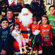 A family poses for a picture with Santa at the Historic Preservation Committee's 2015 Saturday with Santa event. Taylorsville Mayor Larry Johnson plays the part of Santa Claus. (Taylorsville City)