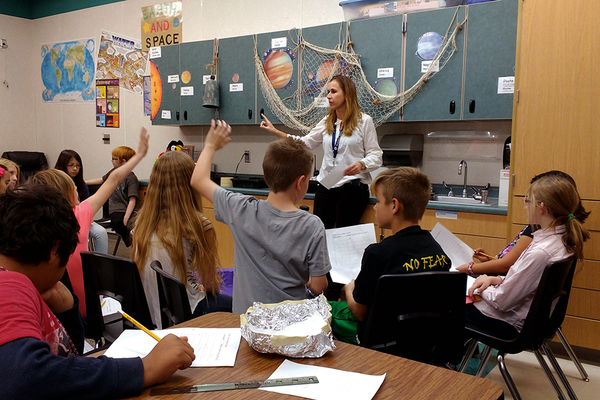 Caroline Hagman has the students learn by observing each team's results. (Jet Burnham/City Journals)