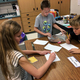 Gabriella Marty, Tayler Miller and Kaden Nicholas design a raft with limited materials. (Melinda Flint/Columbia Elementary)