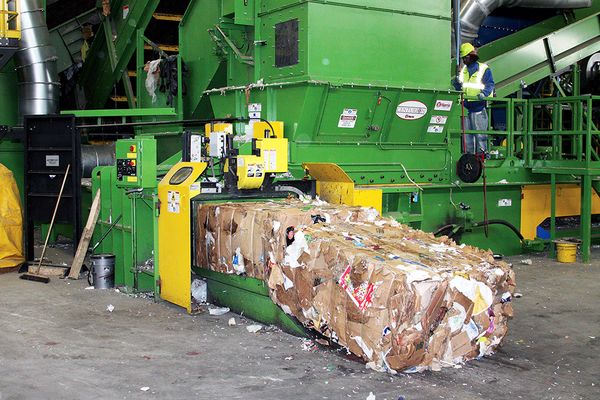 "Bales of cardboard are run through the baler at Waste Management. West Valley City runs a campaign with Waste Management called, ""Recycle often, recycle right,"" to encourage proper recycling methods. (Waste Management)"