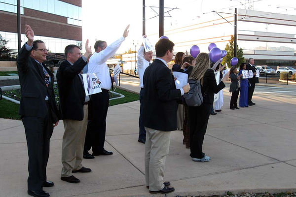 West Valley City officials wave to passersby as part of the honk and wave portion in front of City Hall on Oct. 25. Passing vehicles could honk and wave as they passed to express support for Domestic Violence Awareness Month. (Travis Barton/City Journals)