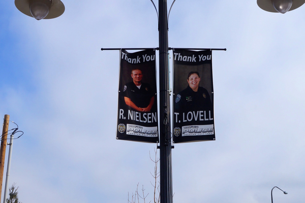 """Thank you"" lamppost banners throughout Holladay Village. (Aspen Perry)"