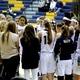 Skyline High School girls basketball team listens to Head Coach Lynette Schroeder in between quarters on Jan. 6. (jorgiabarryphoto)