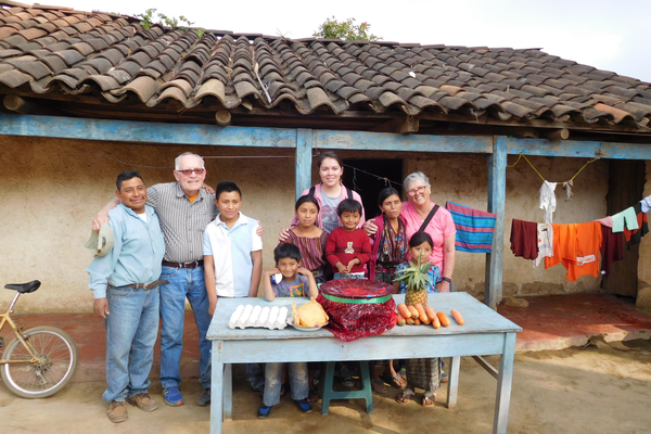 The Leaver family sponsored the girl in this family. Here they are in front of the food that was purchased for them. (Diane Leaver)