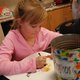 Cynthia Dahl works on her colorful drawing. (Keyra Kristoffersen/City Journals)