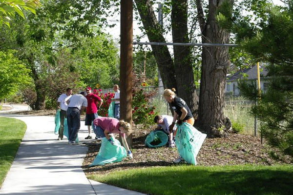 Weeding flower beds during Sandy Pride Day. (Mike Coulam/Sandy City)