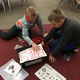 Max McInnis and Kyle Gowen, both sixth-graders at Rose Creek Elementary, participate in the school's first robotics club. (Tori La Rue/City Journals)