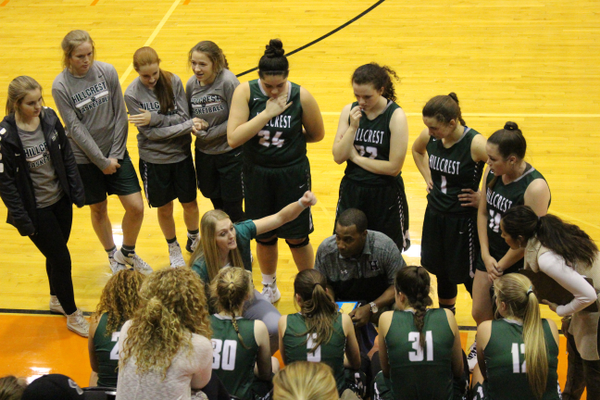 Head coach Shannon Hurst and her assistant coach Anthony Alford speak with the team during a timeout. (Travis Barton/City Journals)