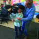 Anthony Thompson, with the help of Photographer John Eulberg, got to hold the television camera when KUTV Good4Utah aired from his Grant Elementary classroom. (Julie Slama/City Journals)