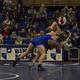 A Bingham wrestler takes an opponent to the mat in a match. (Lauren Heap/Resident)