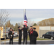 Firefighters raise the colors at the newest fire station. Station 63 is now operational in the city. (Briana Kelley/City Journals)