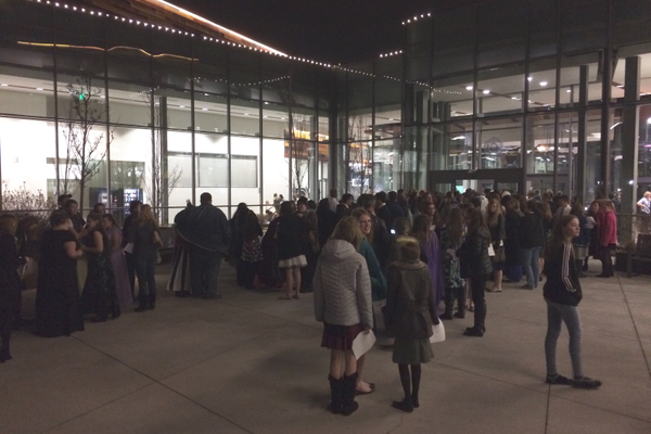 Yule Ball attendees wait patiently outside for the doors to open. (Marina McTee/City Journals)