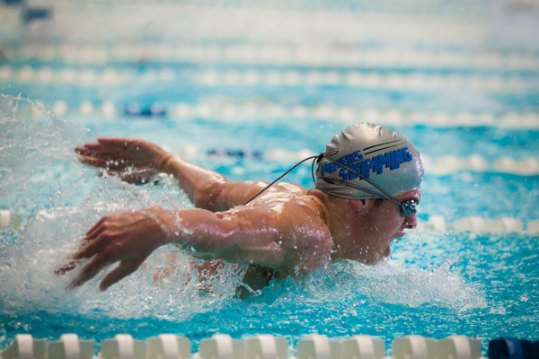 A swimmer from Bingham's boys team moves ahead with the breaststroke (Treasureyourmemories Photography)