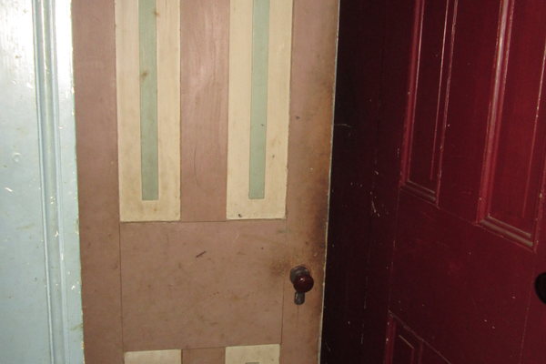 The interior doors in the 1836 portion of the home have old paint which may be original.