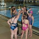 Teachers and swimmers perform their team cheer at the end of the otter and adaptive swim classes. (Travis Barton/City Journals)