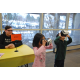 Logan Lee and Anuhea Kau enjoy the day of the tiger within David Selberg's virtual reality glasses. (Keyra Kristoffersen/City Journal)