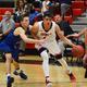 An Alta basketball player drives around an opponent earlier this season. (James Falls/Alta High School)