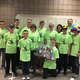 The Oquirrh Hills Middle School FIRST Robotics Competition team, the Velocity Raptors, poses with the robot the team created this year. (Todd Monson)