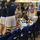 The Taylorsville girls basketball team huddles around head coach Jodi Lee for instructions. (Greg James/City Journals)