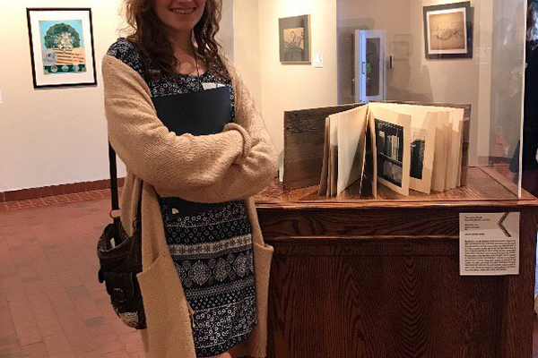 Cassandra Parkin with her award-winning piece at the Springville Museum of Art Exhibit. (Christine Fedor/Copper Hills High School)