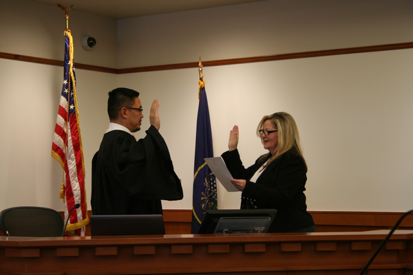 Judge George Vo-Duc is sworn in by City Recorder Rori Andreason. Vo-Duc comes from the Salt Lake County where he served as a deputy district attorney. (Midvale Justice Court)