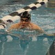 Senior Timothy Hui swims the 100-yard breaststroke at the 4A state championships. (Travis Barton/City Journals)