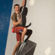 Nathaniel Coleman pumps his fist after reaching the top on his first attempt at USA Climbing's Bouldering Open National Championship at the Salt Palace Convention Center. (Jon Vickers/Momentum Indoor Climbing)